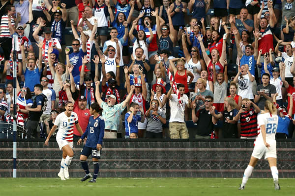 Alex Morgan #13 of the United States celebrates with Emily Sonnett #22 after scoring during their Tournament Of Nations match against Japan at Children's Mercy Park on July 26, 2018 in Kansas City, Kansas.