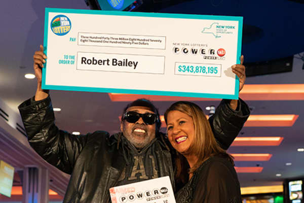 Robert Bailey accepts his check from the New York Lottery.
