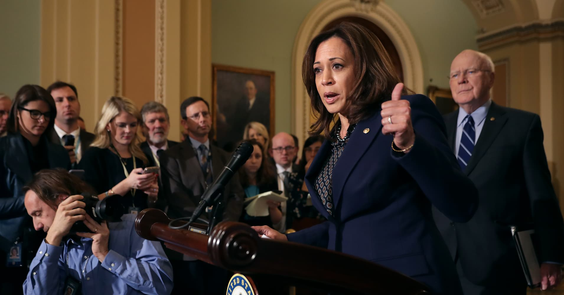 Kamala Harris preaches unity, hits out at Trump's border wall fight