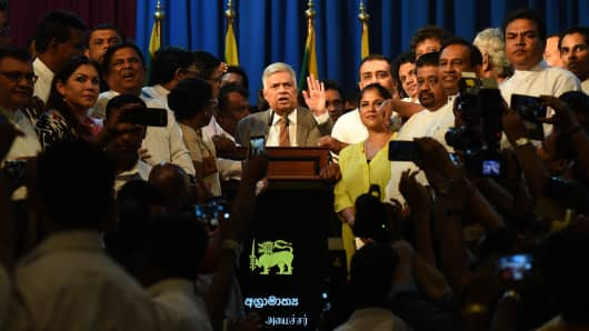 Sri Lanka Prime Minister Ranil Wickremesinghe, center, speaks to supporters at the prime minister's official residence in Colombo on December 16, 2018.