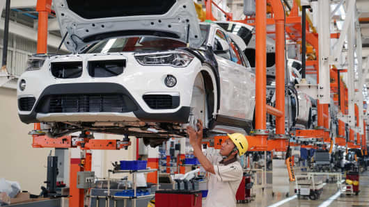 An employee assembles a BMW AG X3 sport utility vehicles (SUV) on the production line at a PT Gaya Motor plant in Jakarta, Indonesia, on Wednesday, July 18, 2018.