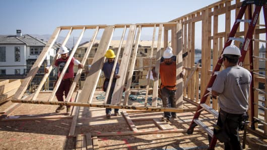 Contractors work on townhouses under construction at the PulteGroup Metro housing development in Milpitas, California.
