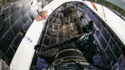 A look at the first Lockheed Martin-built GPS III satellite as it is put into the nosecone of a SpaceX Falcon 9 rocket.