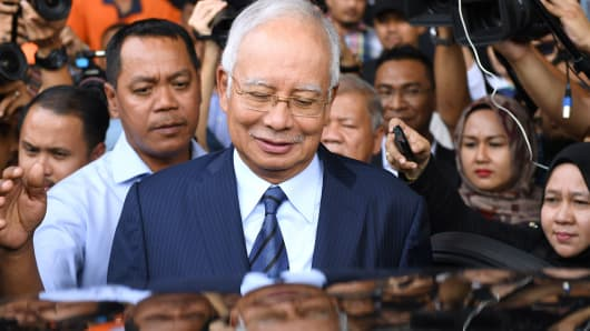Former Malaysian prime minister Najib Razak leaves the courthouse in Kuala Lumpur on December 12, 2018 after being charged in court.