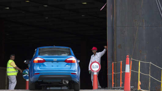 A Ford Motor Co. vehicle arrives at an inspection point before being loaded onto a cargo ship at the Port of Veracruz in Veracruz, Mexico.
