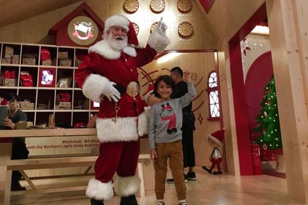 Santa Rick with a child at Hong Kong's IFC mall in November 2018.