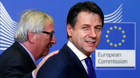 Italian Prime Minister Giuseppe Conte poses with European Commission President Jean-Claude Juncker ahead of a meeting at the EU Commission headquarters in Brussels, Belgium December 12, 2018.