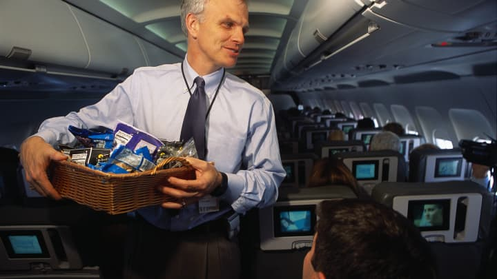 JetBlue Airways' CEO David Neeleman acts as a flight attendant during a flight from John F. Kennedy International Airport to Syracuse and back.