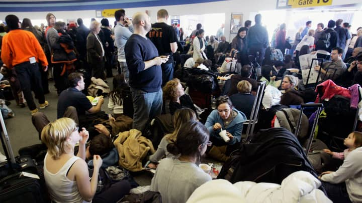 JetBlue Airways passengers wait for flights at New York's John F. Kennedy Airport, in this Feb. 15, 2007 file photo.