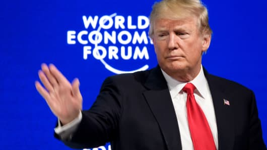 President Donald Trump waves after delivering his speech during the World Economic Forum (WEF) annual meeting on January 26, 2018 in Davos, Switzerland.