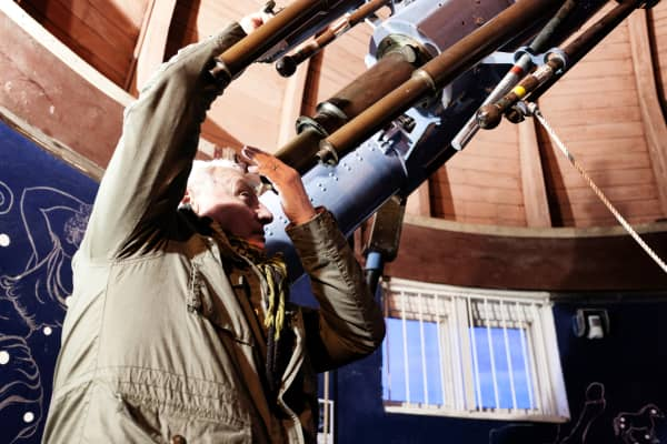 An astronomer using a telescope in a dome at the Norman Lockyer Observatory in Sidmouth, United Kingdom.