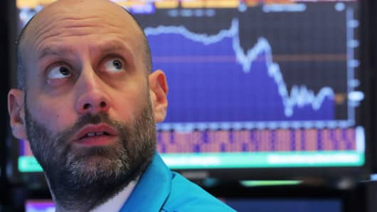 A trader works at his post on the floor of the New York Stock Exchange, December 19, 2018.