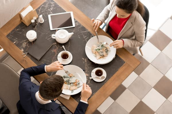 Business partners having lunch together