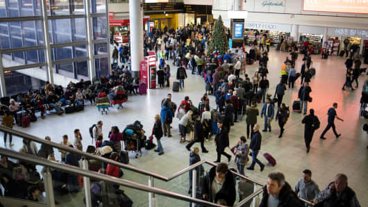 Passengers wait for announcements at Gatwick South Terminal on December 20, 2018 in London, England. Authorities at Gatwick closed the runway after drones were spotted over the airport on the night of December 19.