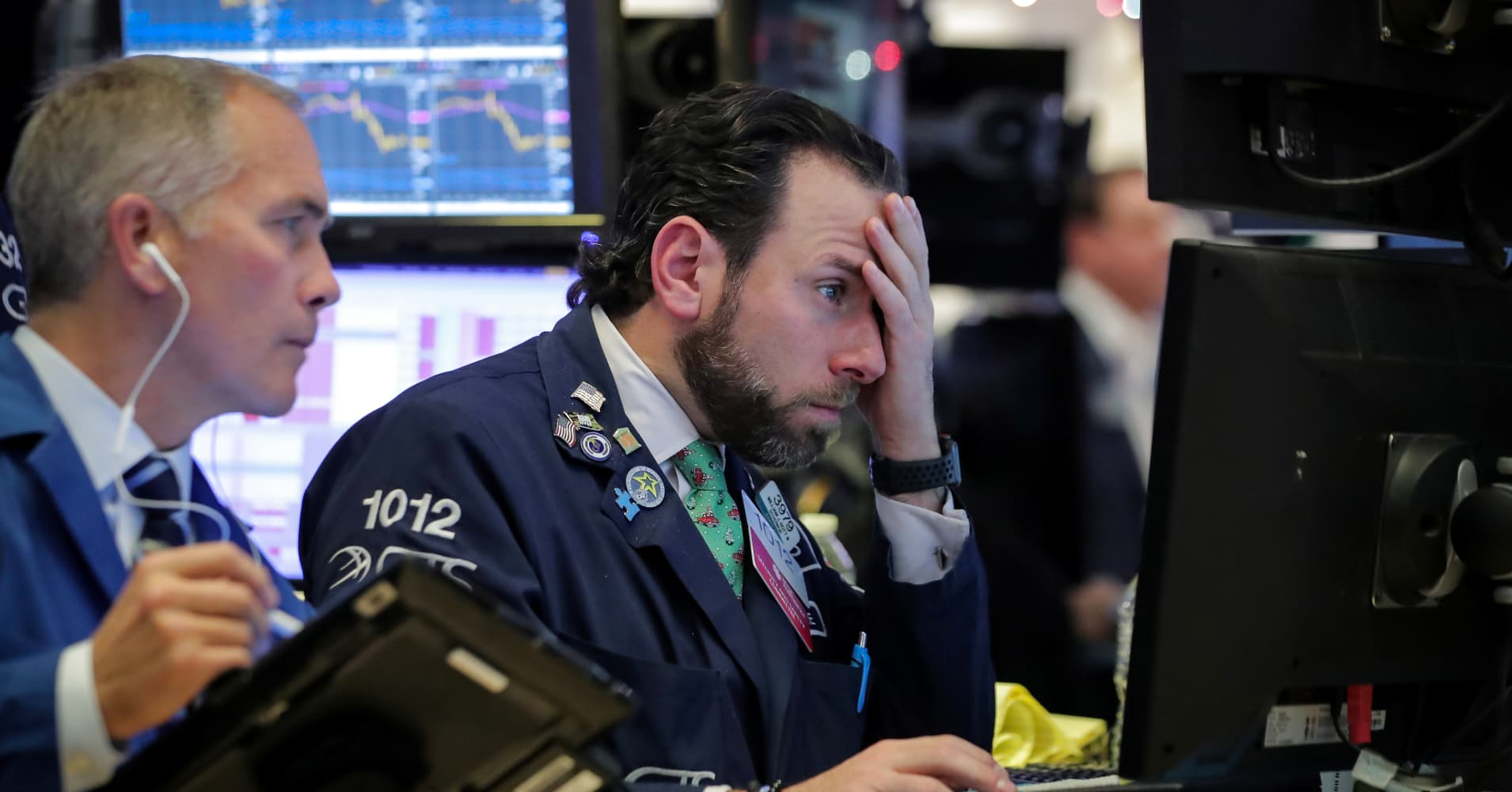 A trader works at his post on the floor of the New York Stock Exchange (NYSE) in New York.