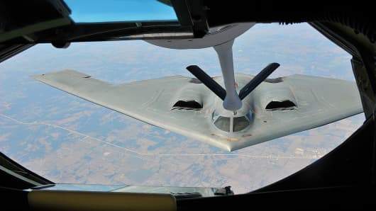 A KC-135 Stratotanker aircraft refuels a B-2 Spirit aircraft with the 509th Bomb Wing over Kansas Aug. 29, 2012.