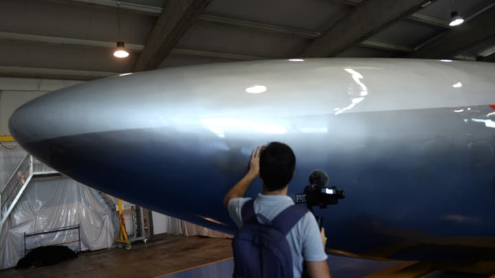 A man touches the rear of a full-scale passenger Hyperloop capsule unveiled by Hyperloop Transportation Technologies on October 2, 2018 in El Puerto de Santa Maria.