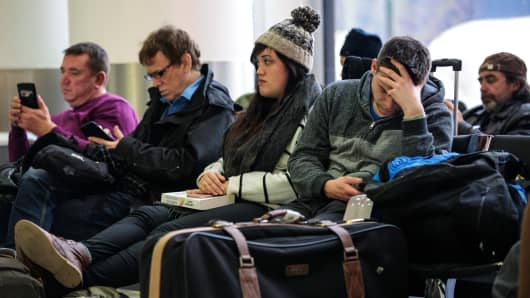 Passengers wait in the South Terminal building at London Gatwick Airport on December 21, 2018 in London, England.