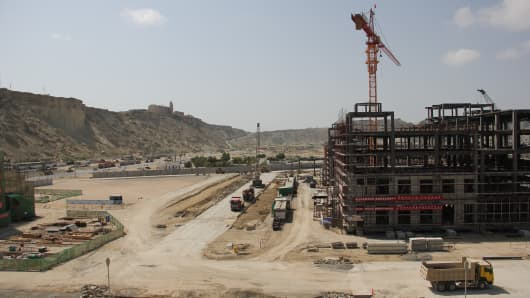 Construction work taking place in the port of Gwadar, Balochistan, in the southernmost tip of Pakistan on October 4 2017. Gwadar, which is supposed to become the largest shipping port of South Asia by 2022, is a hub of the 'China-Pakistan Economic Corridor' that is under China's world-wide network of trade routes.