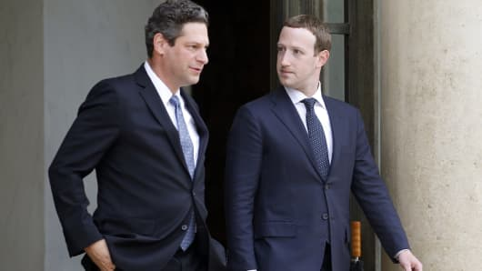 Facebook vice president of global public policy Joel Kaplan and Facebook CEO Mark Zuckerberg leave the Elysee Presidential Palace after a meeting with French President Emmanuel Macron on May 23, 2018 in Paris, France.