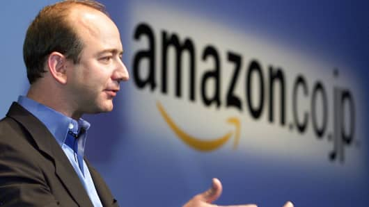 Jeff Bezos, founder and CEO of Amazon.com, speaks at a press conference in Tokyo on June 13, 2001.