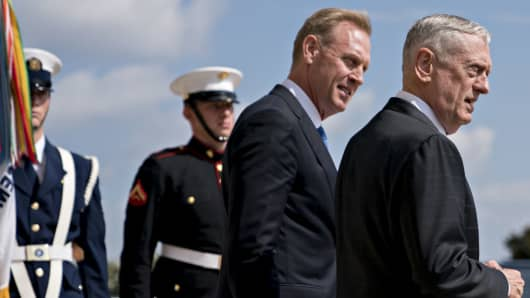 James Mattis, U.S. Secretary of Defense, right, and Patrick Shanahan, Deputy Secretary of Defense, wait outside the Pentagon before an event in Washington, D.C., on Thursday, Aug. 9, 2018.
