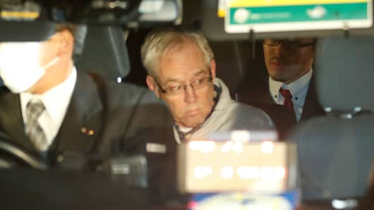 Greg Kelly, the former deputy of ousted Nissan chairman Carlos Ghosn, is seen in the car, as he leaves after being released from a detention centre in Tokyo, Japan, December 25, 2018.