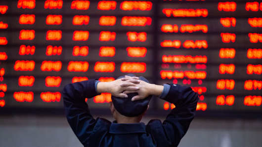 NANJING, CHINA - DECEMBER 03: An investor watches the electronic board at a stock exchange hall on December 3, 2018 in Nanjing, Jiangsu Province of China.