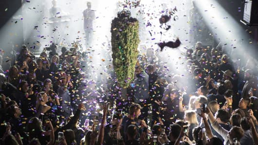 A depiction of a cannabis bud drops from the ceiling at Leafly's countdown party in Toronto on Wednesday, Oct. 17, 2018, as midnight passes and marks the first day of the legalization of cannabis across Canada.