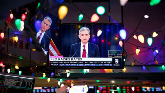 A television broadcasts Jerome Powell, chairman of the U.S. Federal Reserve, announcing an increase in the Federal Reserve interest rate on the floor of the New York Stock Exchange (NYSE) in New York, U.S., on Wednesday, Dec. 19, 2018.