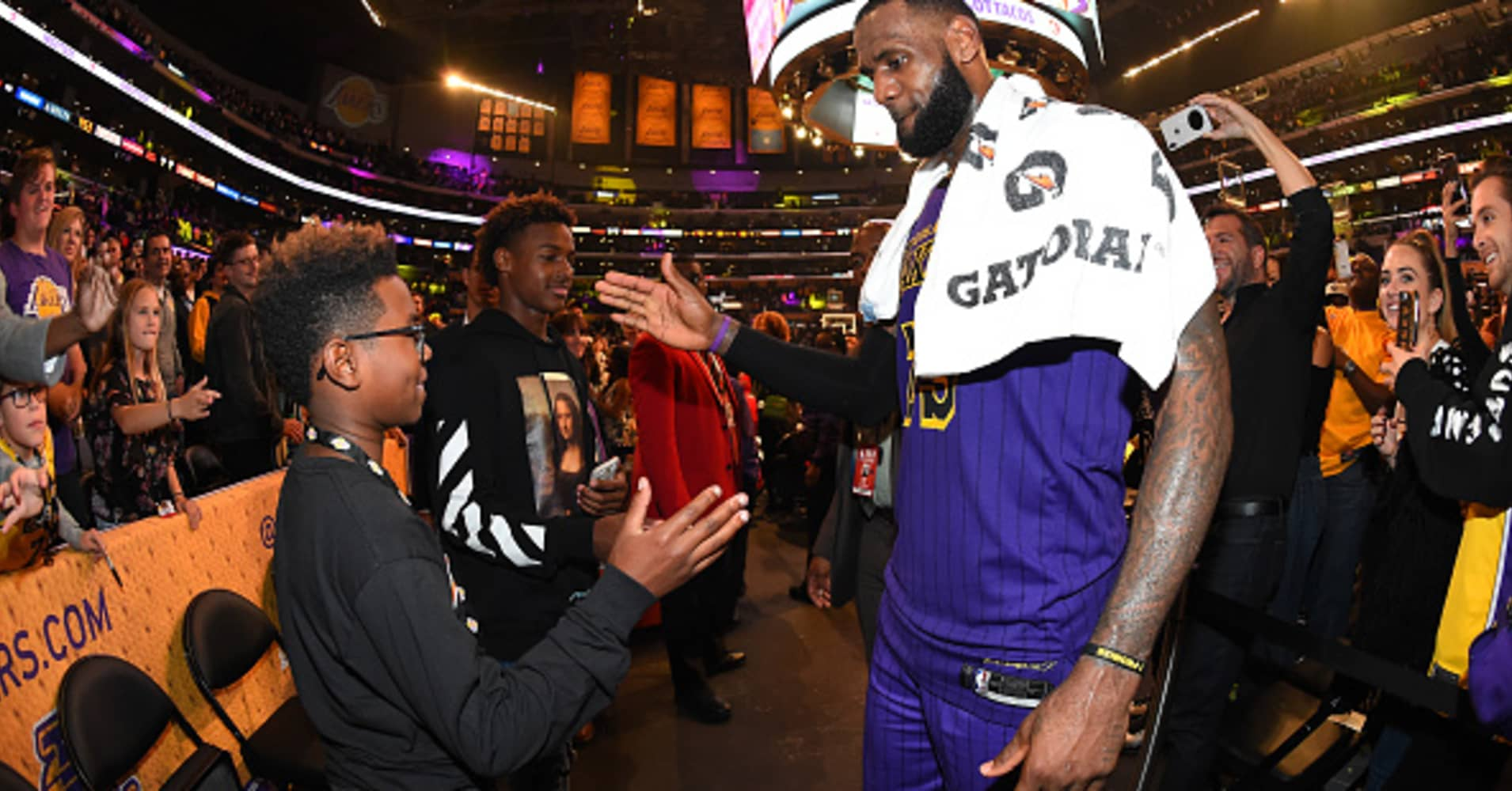LeBron James #23 of the Los Angeles Lakers is seen shaking hands with his sons Bryce Maximus James and LeBron James Jr. after winning the game against the Utah Jazz on November 23, 2018 at STAPLES Center in Los Angeles, California.