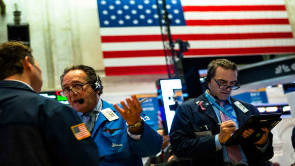 Futures point to higher open following wild swings