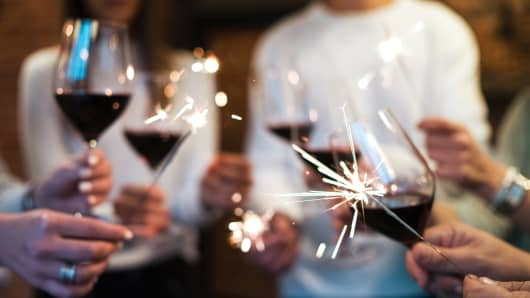 Close up on Hands holding a Glasses of Wine, Toasting, Celebrating