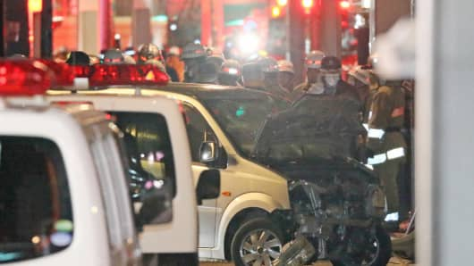 Police inspect a car whose driver rammed his vehicle into crowds in Tokyo early January 1, 2019.