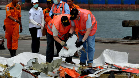The investigation team inspecting debris from the crashed aircraft of the Lion Air JT 610 at the Jakarta International Container Terminal Port's evacuation post, Priok, Jakarta, on Nov. 1, 2018. The Boeing 737 MAX 8 crashed into the Java Sea after takeoff from Jakarta on Oct. 29, 2018, killing 189.