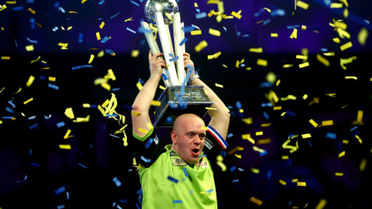 Michael van Gerwen of the Netherlands lifts the trophy after victory in the Final match against Michael Smith of England during Day 17 of the 2019 William Hill World Darts Championship at Alexandra Palace on January 01, 2019 in London, United Kingdom.