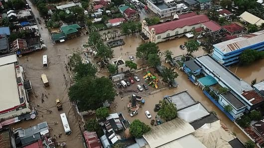 General view of a flooded area in the town of Baao in Camarines Sur province on December 30, 2018.