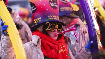 A lady poses for a photo during the annual New Year's Eve celebration at Times Square in New York, the United States, Jan. 1, 2019.