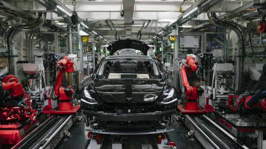 A Tesla Model 3 will be on Thursday, July 26, 2018, on the assembly line of the Tesla factory in Fremont, California.