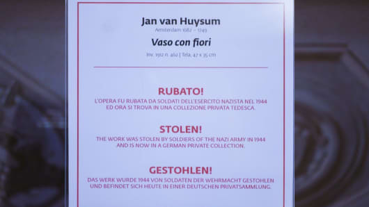 """A sign reading """"Stolen!"""" hangs in the gallery."""