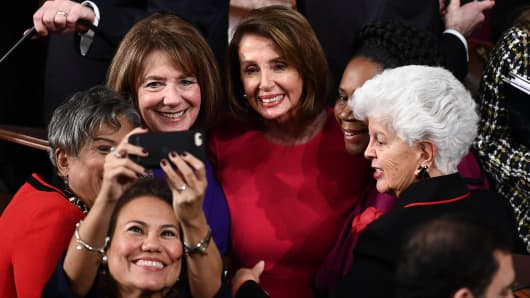 Incoming House Speaker Nancy Pelosi (C), D-CA, is photographed with fellow Congresswomen during the opening session of the 116th Congress at the US Capitol in Washington, DC, January 3, 2019.