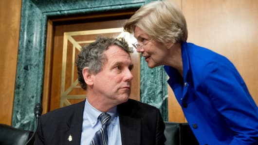 Sen. Sherrod Brown (D-Ohio), left, speaks with Sen. Elizabeth Warren (D-Mass.), during a Senate Banking, Housing and Urban Affairs  in Washington, DC.
