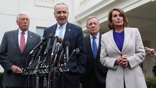 House Speaker Nancy Pelosi (R), D-CA, Senate Minority Leader Chuck Schumer (2nd-L), D-NY, Rep. Steny Hoyer (L), D-MD, and Senator Dick Durbin (2nd-R), D-IL, speak to the media after meeting with US President Donald Trump to discuss the partial government shutdown, January 4, 2019 at the White House in Washington, DC.