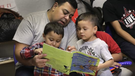 Immigrant children read at an aid center after being released from U.S. government detention in McAllen, Texas. U.S. Customs and Border Protection (CBP), and ICE, dealing with a surge of asylum seekers, have been releasing recently arrived families, pending immigration court dates, despite continued official 'zero tolerance' immigration policies.