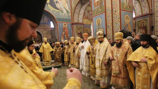 The new-elected Head of Ukrainian Orthodox Church Metropolitan Epifaniy seen as he takes part during the first Liturgy prayers as the new Head of the new united local Ukrainian Orthodox Church at the Michael's Golden-Domed Cathedral in Kiev.