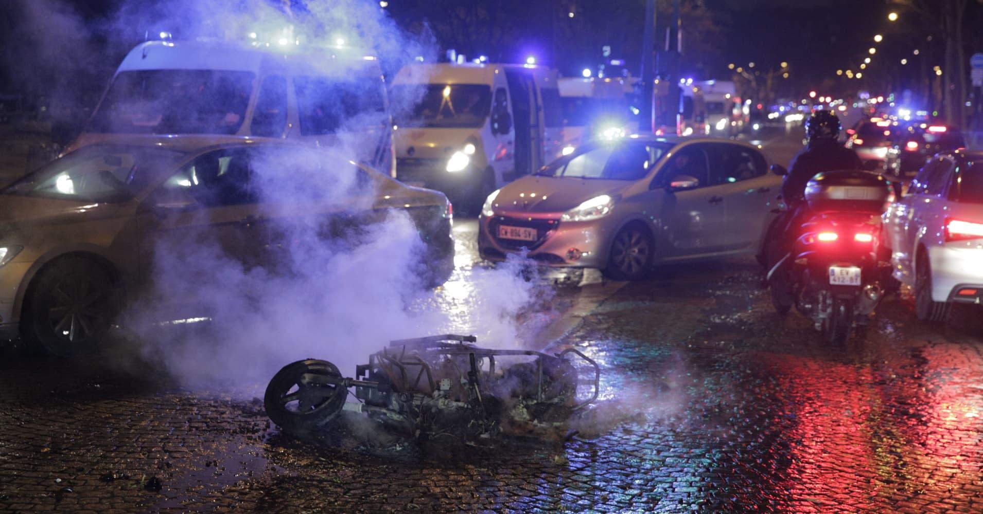 Clashes erupt in Paris as 'yellow vests' protest Emmanuel Macron