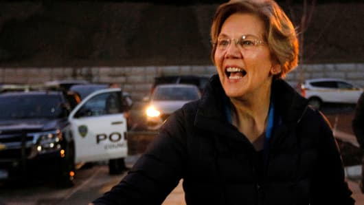 "Senator Elizabeth Warren greets the overflow crowd outside an ""organizing event,"" after forming an exploratory committee for the 2020 presidential race, in Council Bluffs, Iowa, January 4, 2019."