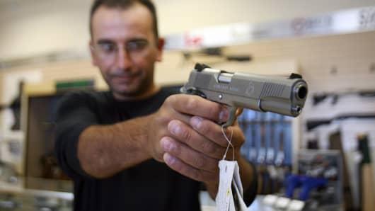 A man buys a gun at the Gun Gallery in Glendale, California.