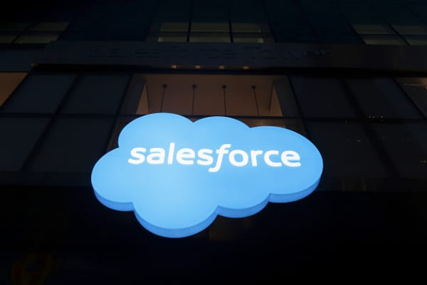 A Salesforce corporate logo sign hangs outside their office building in New York City.