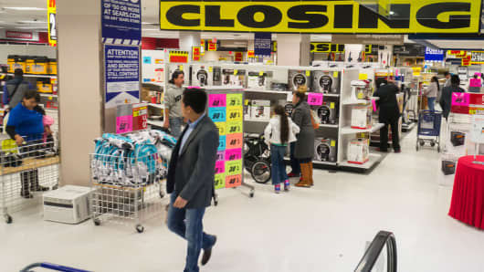 Customers browsing at a soon to be closing Sears store.